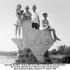 From left, Sue Ellen, Thomas Hill, Jerry LeRoy, and Kathryn Louise Reynolds.<br /> On vacation with their mom, Kathryn Louise, and her parents,<br /> Bess and Ernest Willsey, Galveston, TX  August, 1956