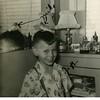 Jeffrey Warren Patton with pet parakeet Mike at<br /> Patton home on N. Phoenix in Tulsa, OK.