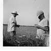 Ernest L. Willsey, left, fishing with his grandson Gene Reynolds.<br /> Mohawk Lake, Tulsa, OK  July, 1953