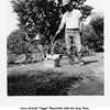 """Jerry Arnold """"Jiggs"""" Reynolds with his dog, Pam.<br /> At his dad Reuben's house.<br /> Hominy, OK  c. 1956"""