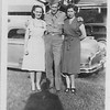 """Thomas Warren """"Bud"""" Patton with sisters<br /> Georgia Dale on left and Freida Ramey on right.<br /> Home on leave at parents home on S. Phoenix.<br /> Tulsa, OK"""