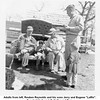 "Adults from left, Reuben Reynolds and his sons Jerry and Eugene ""Laffin"".<br /> Gene's kids from left, Kathy and Tom.<br /> Lunch at ""the farm"".  6 Apr 1952"
