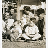 From left, Bill Willsey, his dad Glen, Jerry<br /> Reynolds, Kathy Reynolds being held by<br /> her grandmother Bess Willsey, Gene<br /> Reynolds, and Ernest Willsey.<br /> Ernest and Bess' home, Tulsa, OK Nov 1946