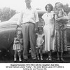 "Eugene Reynolds (1915-1963) with his daughters Sue Ellen,<br /> left and Kathryn Louise ""Kathy"".  His sister Eldora Larue (1911-2004) is<br /> holding his son Thomas Hill.<br /> Eldora's daughter Jennie L. is next to her.<br /> Tulsa, OK Jun 22, 1950"