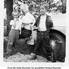 "From left, Kathy Reynolds, her grandfather Reuben Reynolds,<br /> and her brother Jerry LeRoy Reynolds with his first fish.<br /> At the Reynolds ""farm""  June 1952"