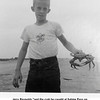 """Jerry Reynolds """"and the crab he caught at Sabine Pass on<br /> McFadden Beach.""""<br /> On vacation, Galveston, TX  8/5/1956"""