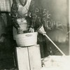 "Eugene Reynolds while he was working in Alaska,<br /> 1942-1943.  His wife, Kathryn, writes on the back,<br /> ""The Irish Washer Woman""."