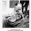 Ernest Willsey and a crab.<br /> At the home of his daughter Maurice Muth.<br /> Baltimore, MD  1954