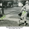 """Batter Jeffrey Warren Patton playing ball with cousin<br /> Maurice Edward """"Eddie"""" Bishop in front of Patton<br /> home on S. Nogales.  Tulsa, c 1950."""