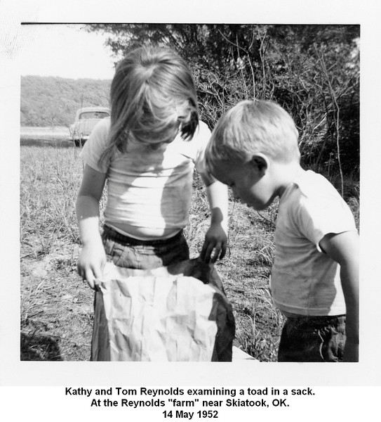 "Kathy and Tom Reynolds examining a toad in a sack.<br /> At the Reynolds ""farm"" near Skiatook, OK.<br /> 14 May 1952"