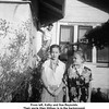 From left, Kathy and Sue Reynolds.<br /> Their uncle Glen Willsey is in the background.<br /> At the home of their grandparents Ernest & Bess Willsey.<br /> Tulsa, OK, Nov 1956