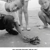 """Jerry and Kathy Reynolds """"with his crab.""""<br /> On vacation, McFadden Beach, Galveston, TX  8/5/1956"""