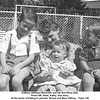 Kathryn (Willsey) Reynolds and her first three kids.<br /> From left, Gene, Kathy, and Jerry.<br /> At the home of Kathryn's parents, Ernest and Bess Willsey.  Tulsa, OK