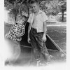 From left, brothers Jerry and Gene Reynolds.<br /> In their front yard.<br /> Tulsa, OK Aug 1952