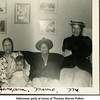 Halloween party at home of Thomas Warren Patton<br /> from left Jane (Patton) Bishop holding daughter Ann,<br /> her husband Maurice Bishop, and Thomas Warren's<br /> mother-in-law Ruth (Haberman) McDonald <br /> Tulsa, OK