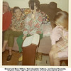 "Ernest and Bess Willsey, their daughter Kathryn, and Donna Reynolds.<br /> Kathryn writes, ""Me with cake turner & waste basket from Tom.""<br /> At Kathryn's house, Tulsa, OK  Christmas, 1970"