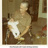 Drew Reynolds with 5 week old Doug Johnston.<br /> Christmas at Drew's home.<br /> Tulsa, OK  1971