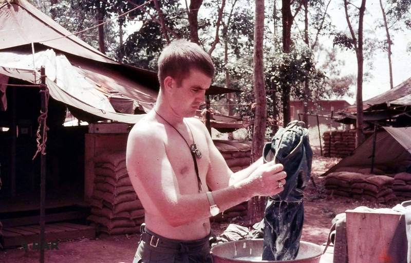 National serviceman, Private John Dever, platoon signalman, then rifleman, 3 section, doing his washing.<br /> tent lines, Nhui Dat, South Vietnam, 1969.<br /> taken by Jim Kelly, rifleman, 3 section.