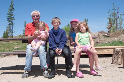 Larry with grandkids, Alie, Coleson, Evie, and Lili.