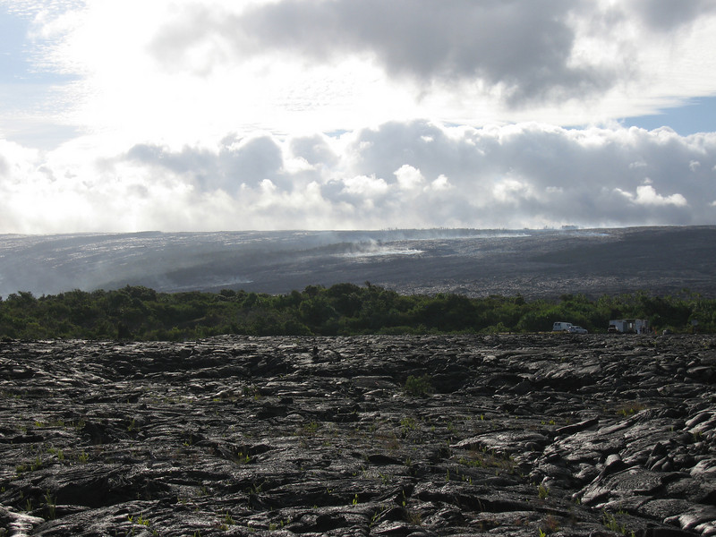 The Royal Gardens area smoldering above the lava tubes flowing to the ocean.