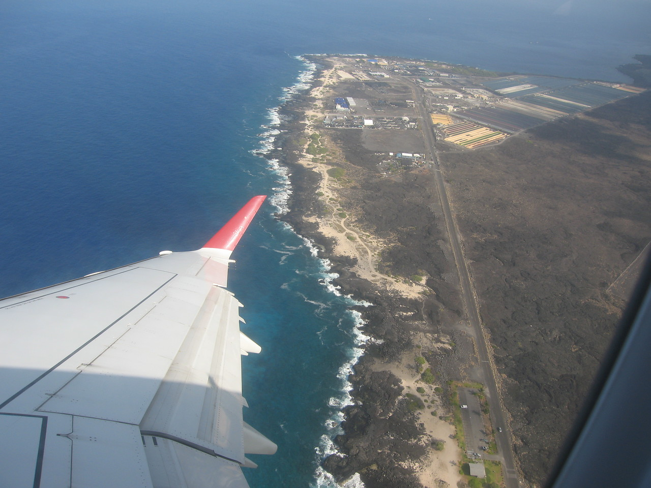 Leaving the Kona airport with the cold water companies (abalone, lobster) on the shoreline below.
