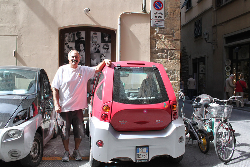 Tiny, electric car.