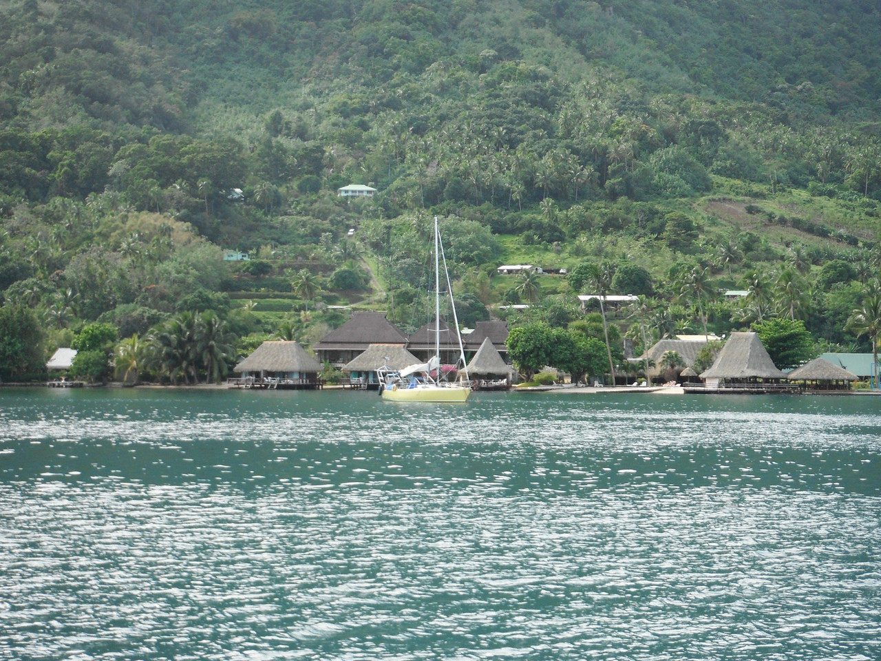 Our 2 bungalows, right behind the yellow sailboat.
