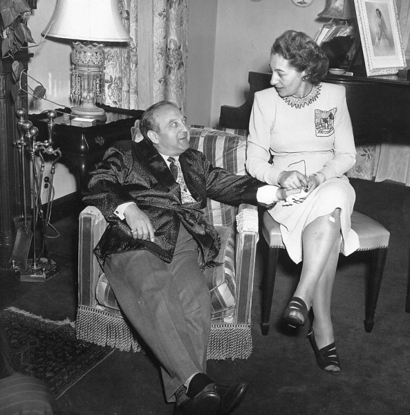 I just love this photo of my grandparents. <br /> <br /> Puppy's so relaxed lounging in his smoking jacket, while Nanna sits so prim & proper beside him. Only the little bandage on her knee mars her perfection.