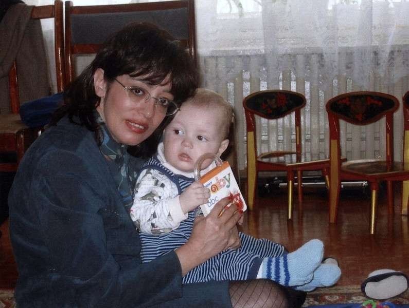 Julie with her new baby, Joshua, at the Detskii Dom (orphanage) in Russia. (04.2003)
