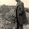 "Warsaw, Poland, Herman Gilman, representative of the ""Joint"", next to the ruins of the Ghetto.<br /> Belongs to collection: Yad Vashem Photo Archive; Origin: The Jewish Archive in Warsaw; Archival Signature: 3306/19"