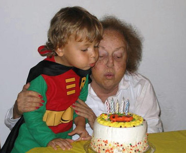 Helping Nanny blow out her birthday candles. (10.2005)