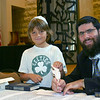 Joshua the Celtics fan at synagogue making his contribution to the Torah they're creating.