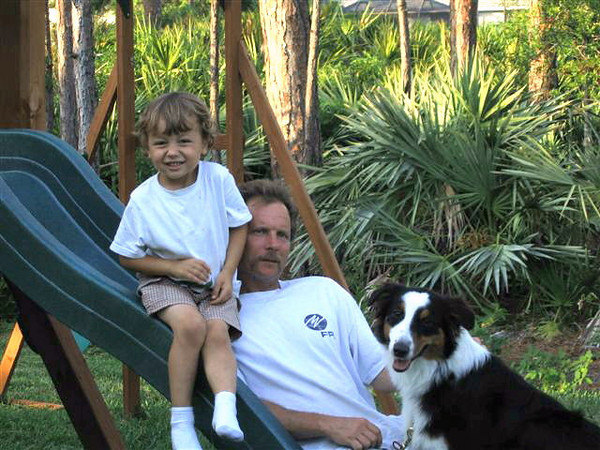 With Dad & our dog, Mattie, in our backyard. (2007)