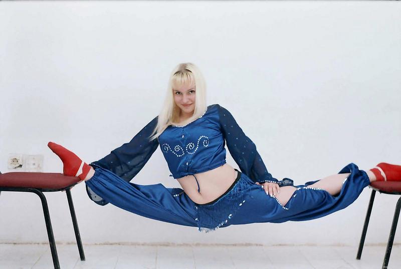 Rustem's niece, Anya, doing a split during her acrobat/gymnast days.