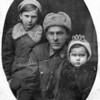 Grandfather & his two girls. Mom Maria & baby Rita.