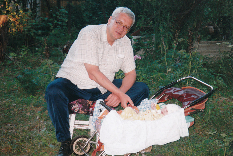 Brother-in-law, Sasha Alexaev, with his grand-daughter at the dacha. (2005)