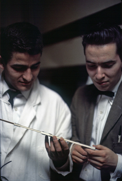 Gsbe Lopez and Denis Cullinan examining a pre-Adamite calculating instrument..