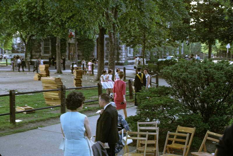 Girl in red dress walks away.