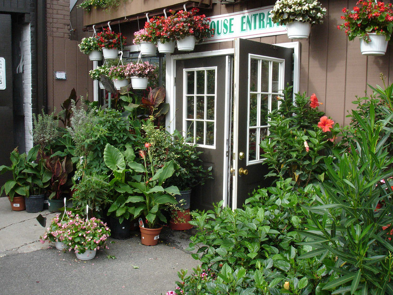 The entrance to the greenhouse is sculpted with  horticultural pretties.