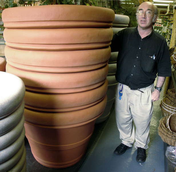 Mark stands next to the biggest planters I ever saw.  Of course, they are plastic, designed to withstand the frosts of New York, before which terra-cotta crumbles in defeat.