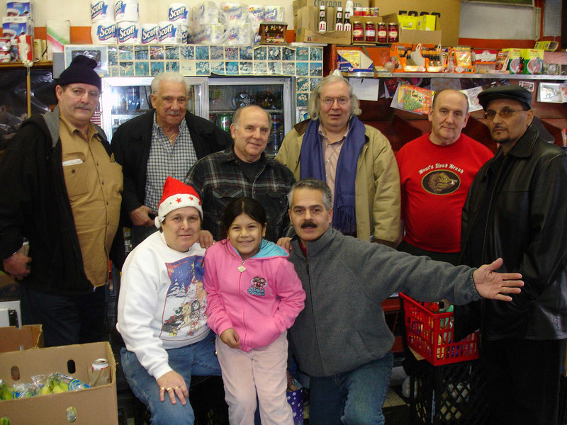 Dec. 24. Rear, left to right: Nino, Armando, Ronnie, me, Paul, Louie.  Sandy is on the left in the front.