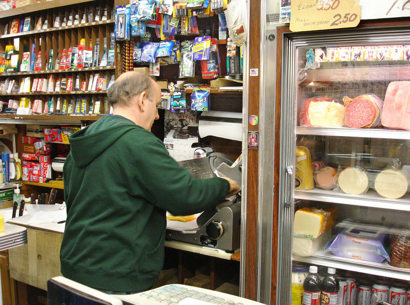 Paulie slicing some American cheese, probably for me.  Feb 4, 2005.