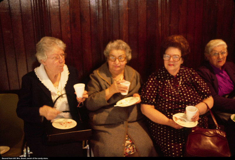 Mrs. Stuart, of candy store fame, is second from left.