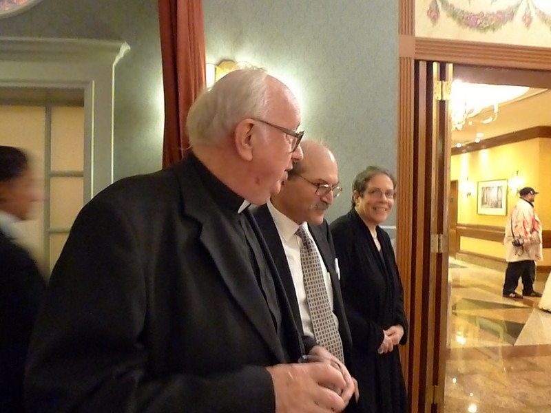 Msgr. Kelly talking with Frank and his wife.