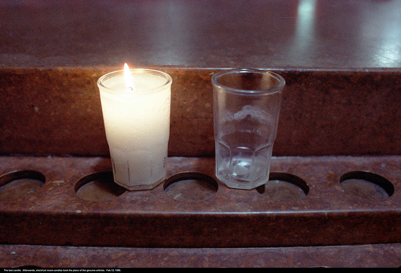 This is the last candle that ever burned in St. Brigid's Church.  It may hap, however, that in some future era more dedicated to the good things of the religious soul, and less harried by the importunities of insurance companies, candles may once again burn their silent paeans.  And they'll be made of beeswax.
