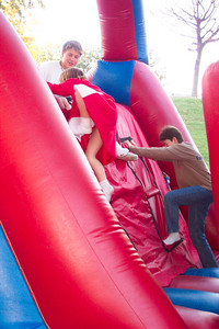 Cate and Patti race on the inflatable obstacle course...