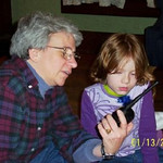 Jeane is giving Cate erudite instructions on using her new walkie-talkies.