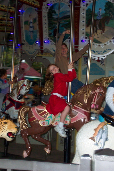 Cate and Patti continue dancing with the merry-go-round.