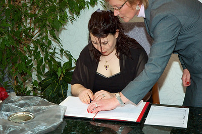 Signing her new name for the first time!  (honestly, she practiced beforehand though) ...