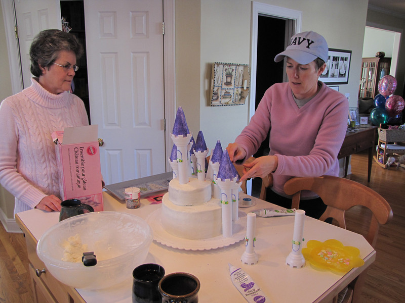It takes a family to decorate a castle cake.